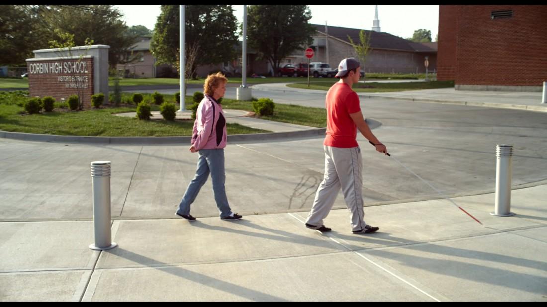 23B_sc096_BBaker_Hapka_Patty and Travis outside school_300dpi