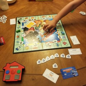 It is WORLD MONOPOLY DAY! We are Playing the New MONOPOLY JUNIOR: Electronic Banking Edition Game!